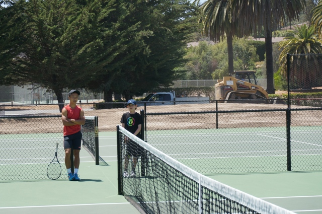 Coach Ben Furukawa and Daniel Newton talking strategy at Laguna Blanca Tennis Camp 2014