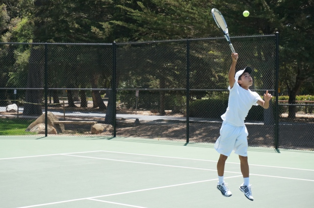 Alex Furukawa nails an overhead at Laguna Blanca Tennis Camp 2014