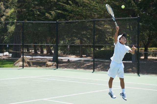 Alex Furukawa nails an overhead at Laguna Blanca Tennis Camp 2014