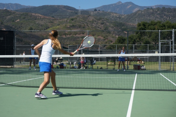 Kate Dehlendorf sticks the forehand volley