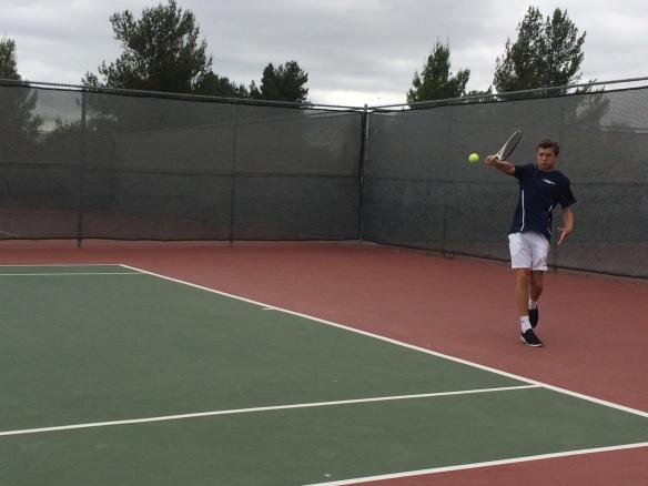 Henry Farrell swats a backhand for Laguna Blanca Tennis