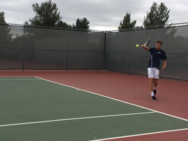 Henry Farrell swats a backhand for Laguna Blanca Tennis
