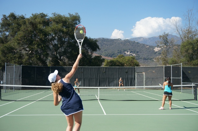 Madeleine Nelson gets the center of the strings on serve